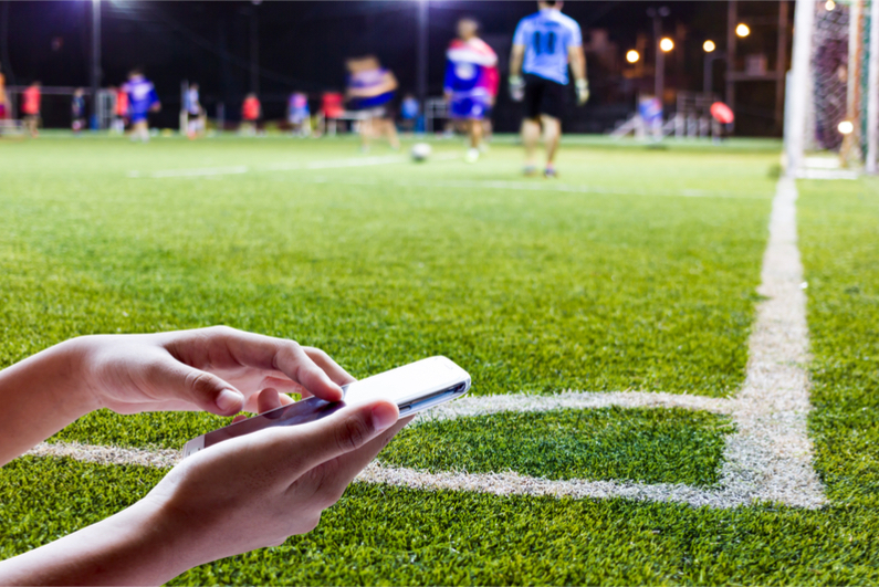 A football pitch and a mobile phone