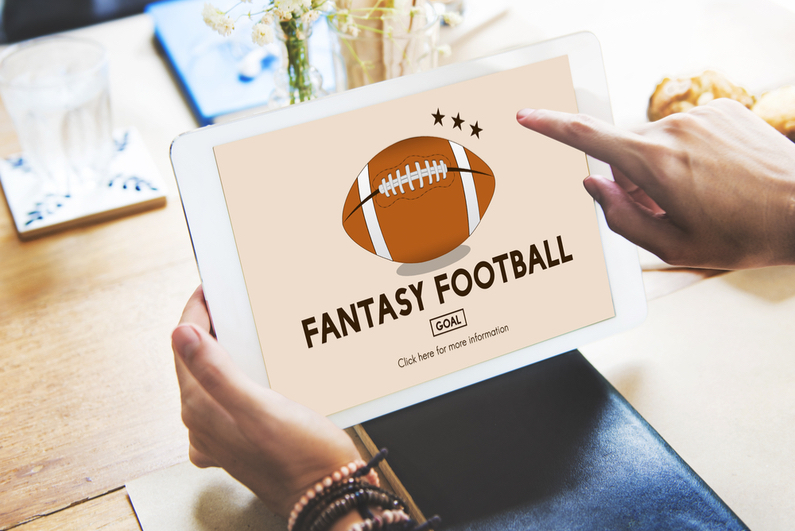 A tablet with a fantasy football sign