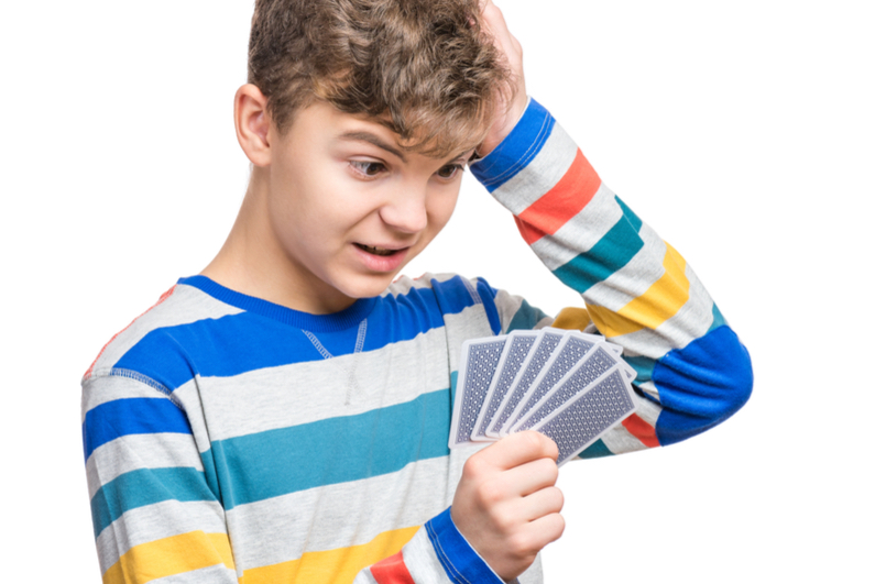 Boy with playing cards
