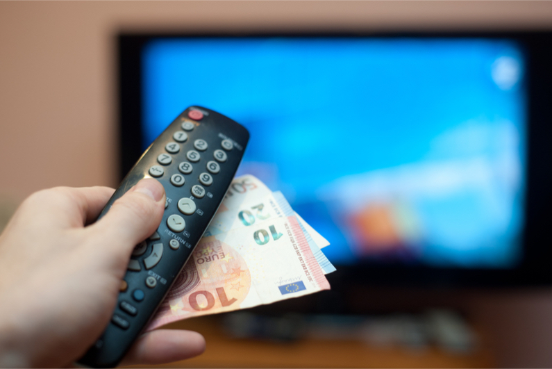 TV with remote control and cash