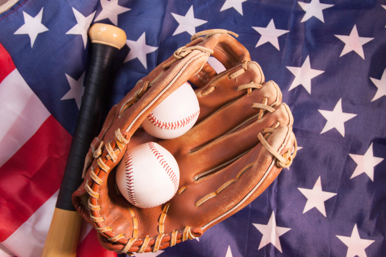 Baseball with glove and American flag