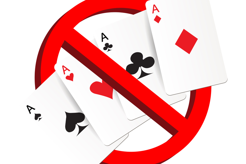 Playing cards and a no entry sign