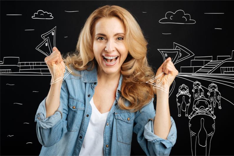 happy-blonde-woman-winning-money
