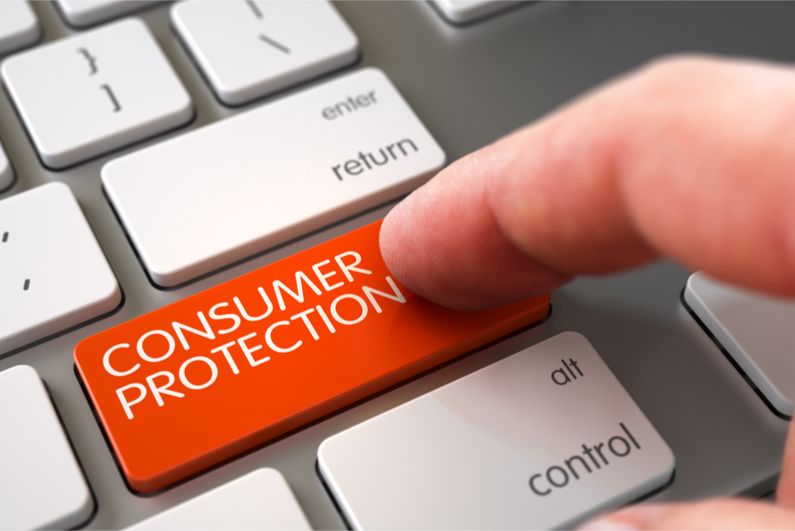 Finger touching CONSUMER PROTECTION key
