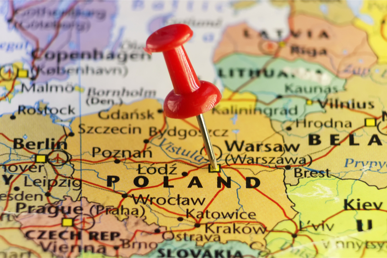 A pin marks the location of Warsaw, Poland's capital