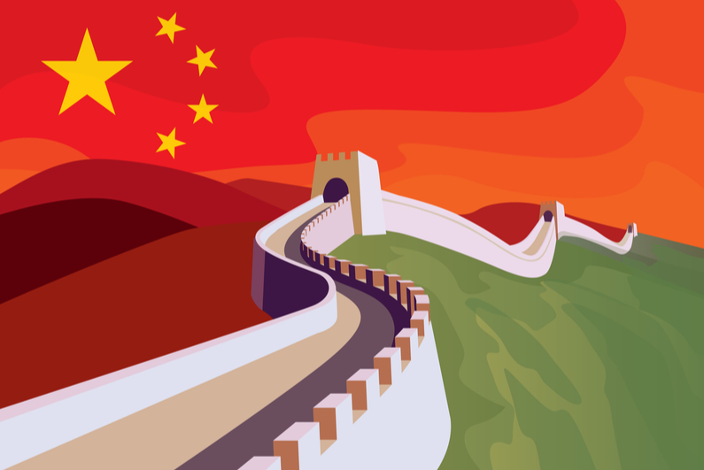 The great Wall of China with Chinese flag in the sky