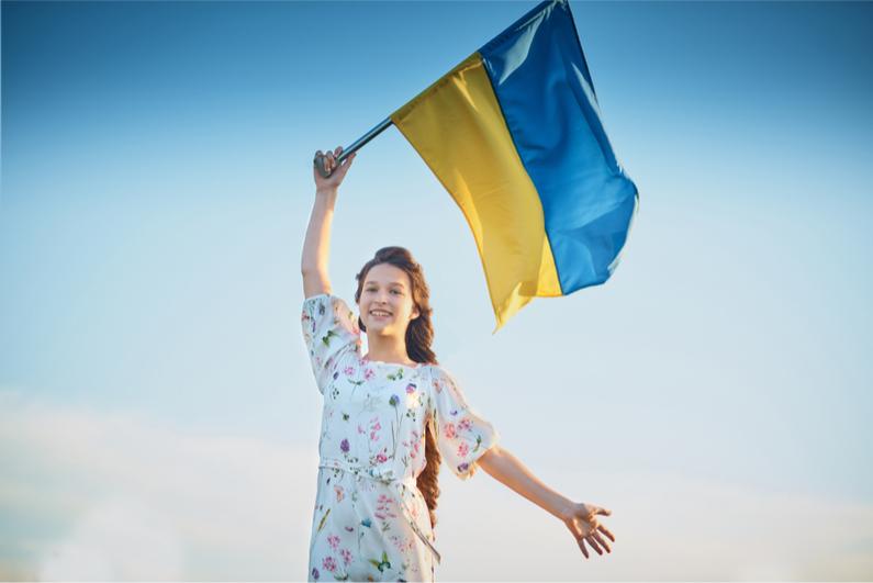 Young girl waving Ukraine flag