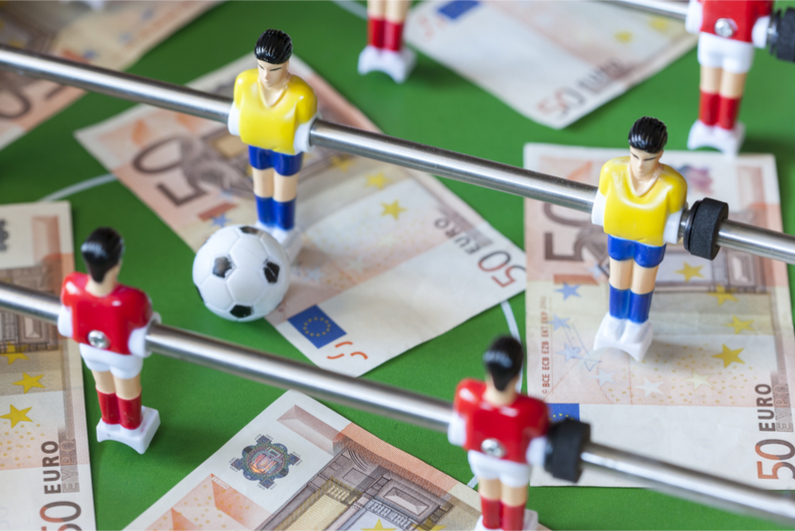 Concept about money spending in football (soccer), sports betting and manipulated fixed matches
