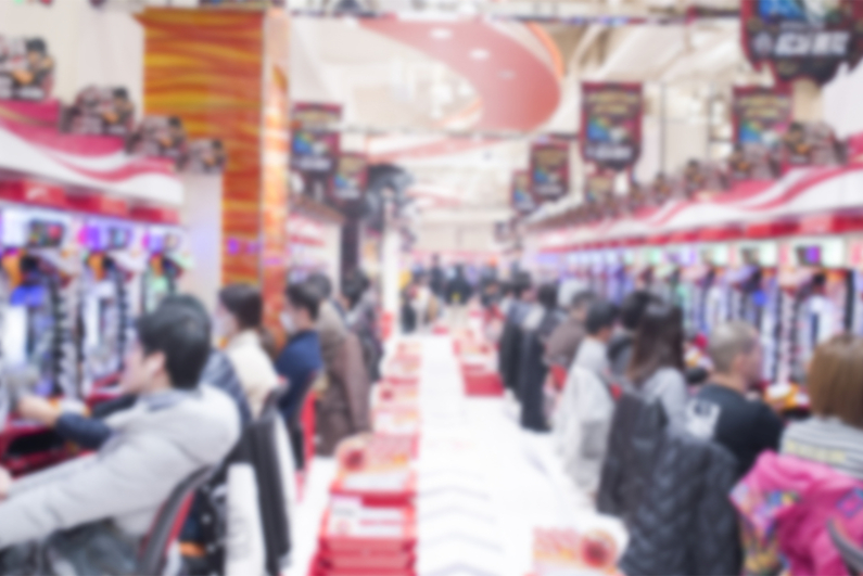 Blurred image of people playing pachinko