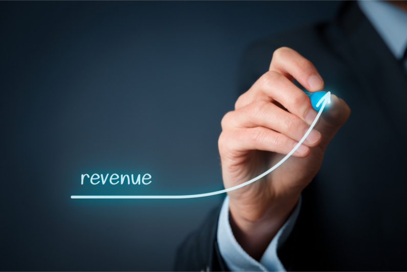 Businesman with revenue graph