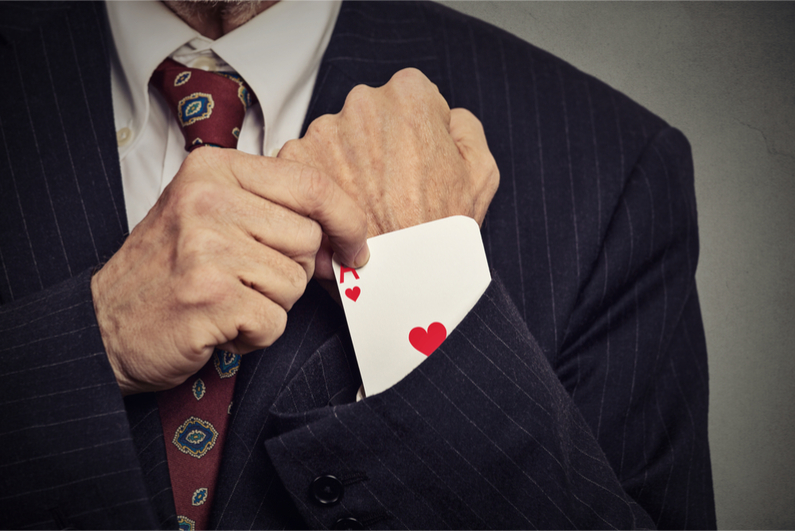 Closeup cropped image of man hand pulling out a hidden ace from his sleeve
