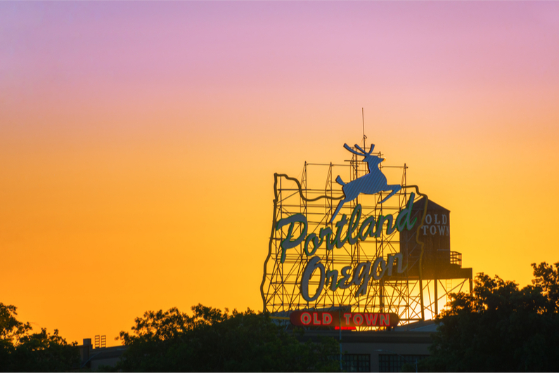 Sunset over the iconic Portland, Oregon Old Town sign