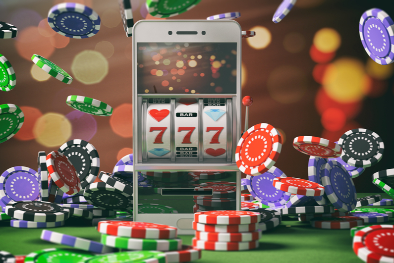 Slot machine on a smartphone screen, poker chips and abstract background