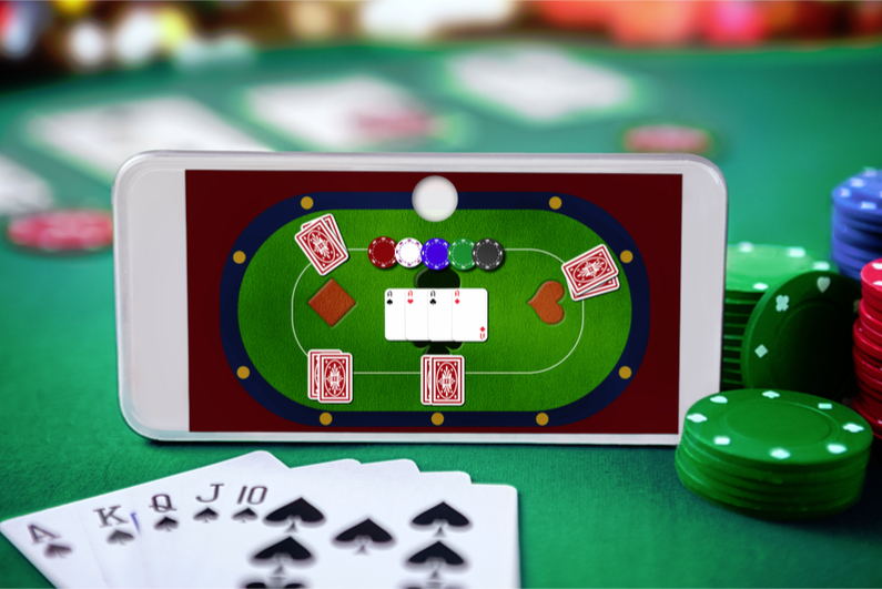 Smartphone with online poker table superimposed