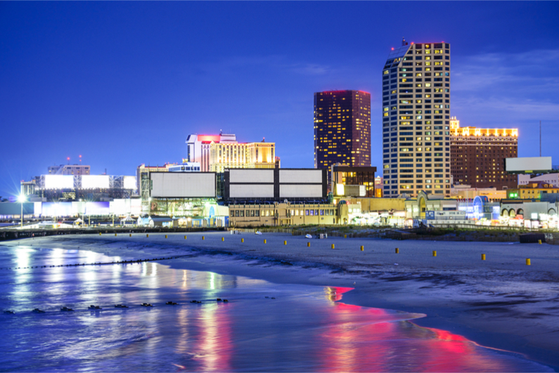 Atlantic City, New Jersey, USA resort casinos cityscape on the shore at night