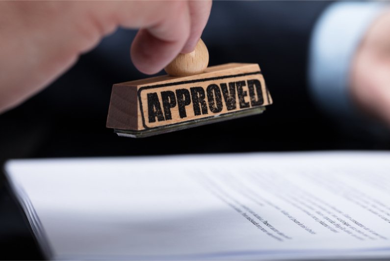 Hand stamping APPROVED on contract form