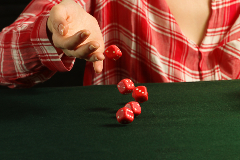Woman rolling red dice