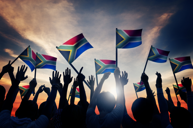 Group of People Waving South African Flags
