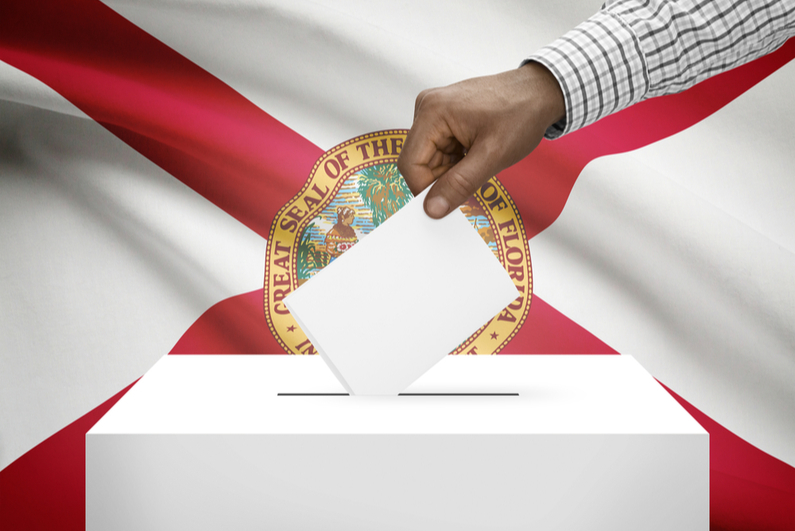 Ballot box with Florida state flag in background