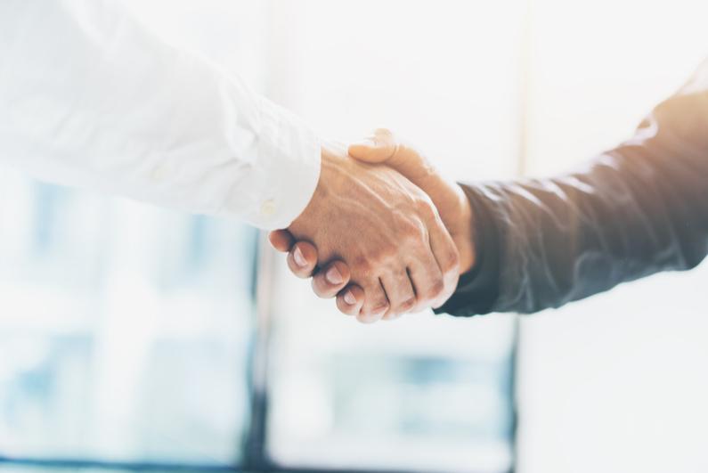 Successful businessmen handshaking after good deal