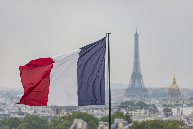 French flag with Eiffel Tower in background
