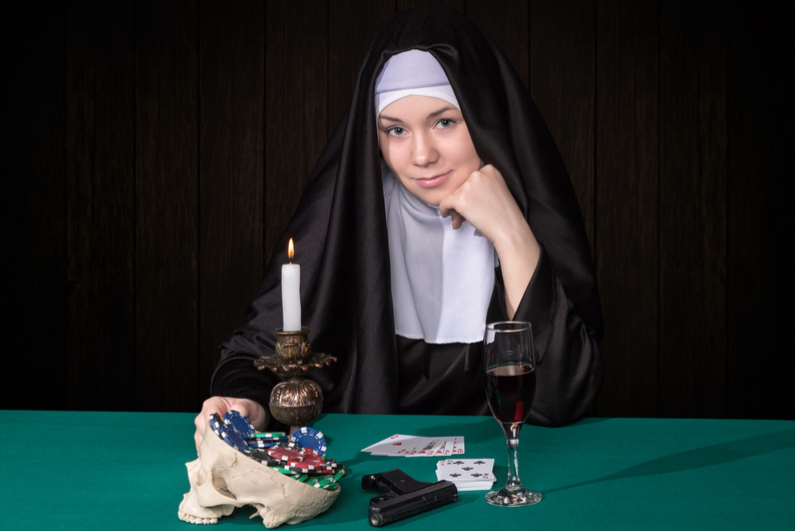 Conceptual portrait of a nun and gambling
