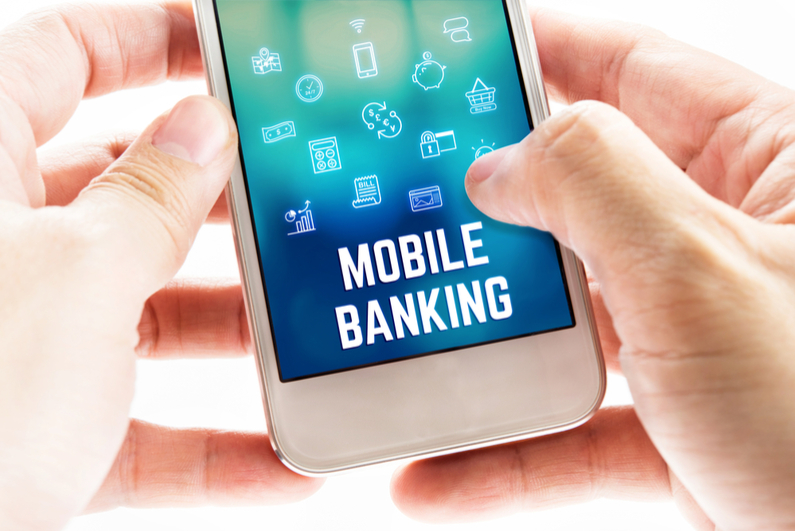 Two hands holding mobile phone with Mobile banking word and icons