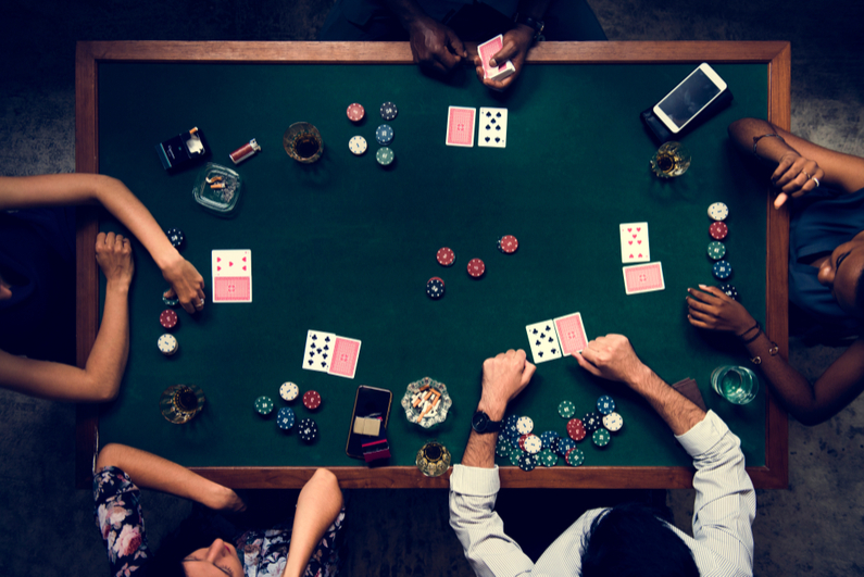 Aerial of people playing poker in casino