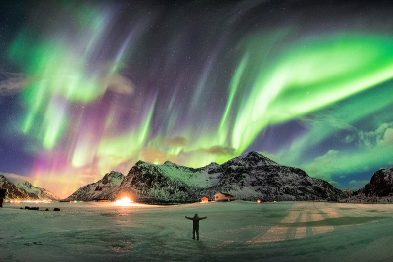 Aurora borealis (Northern Lights) over mountains in Norway