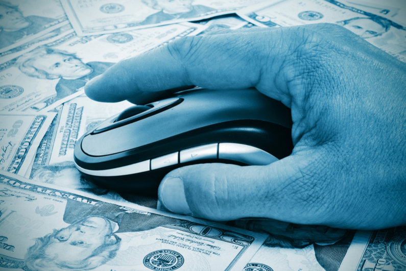 Hand with mouse against background of US currency