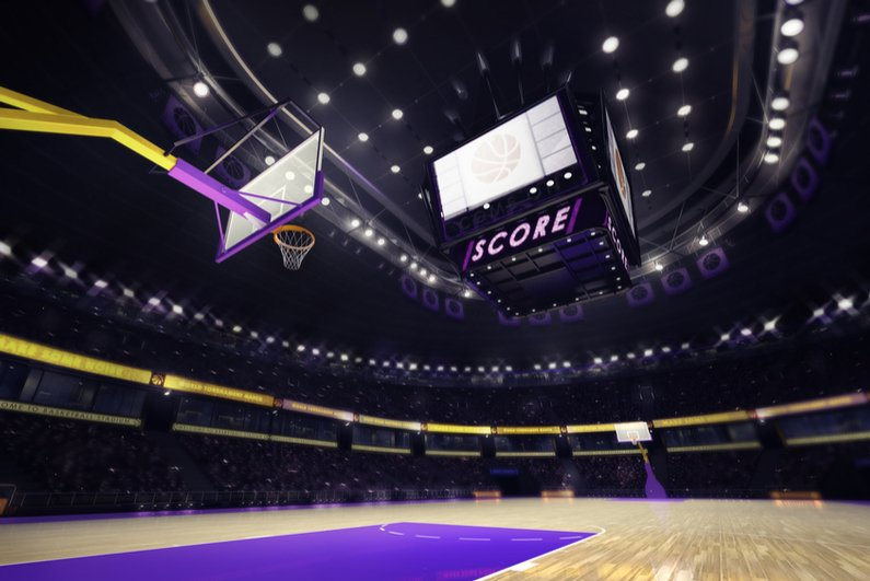 Basketball court with spectators and spotlights