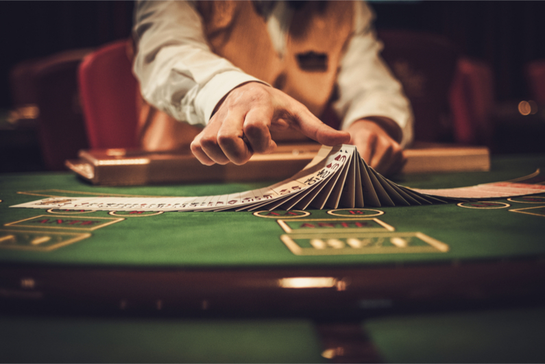 Croupier dealing cards