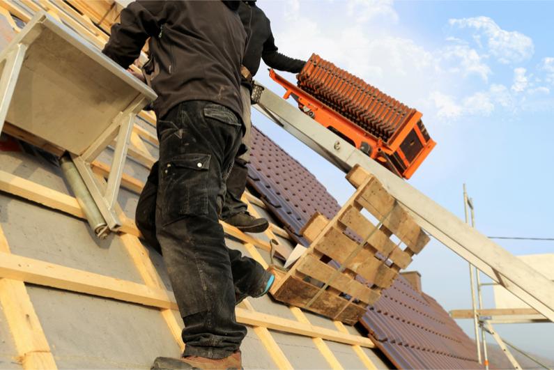 Man repairing a roof