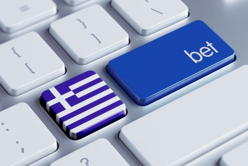 Greek flag and bet keys side by side