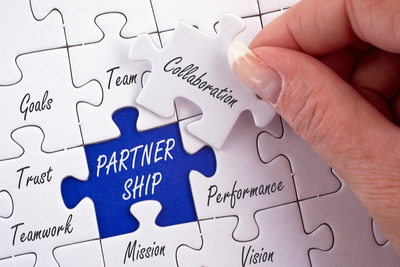 Jigsaw puzzle piece labeled PARTNERSHIP