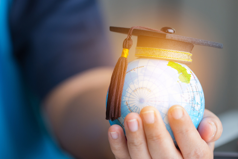 Graduation cap on model of globe
