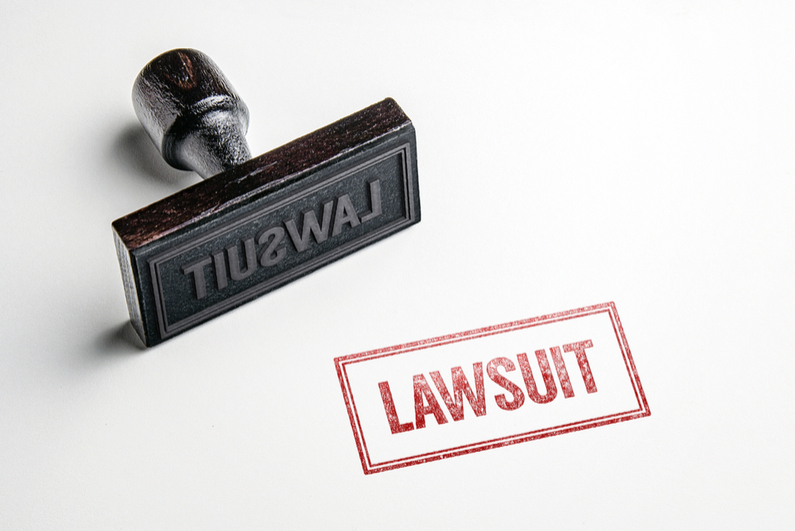 Rubber stamp saying LAWSUIT