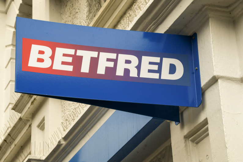 Sign above a Betfred betting shop