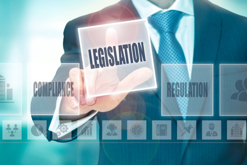 Man in suit pressing LEGISLATION button on transparent screen