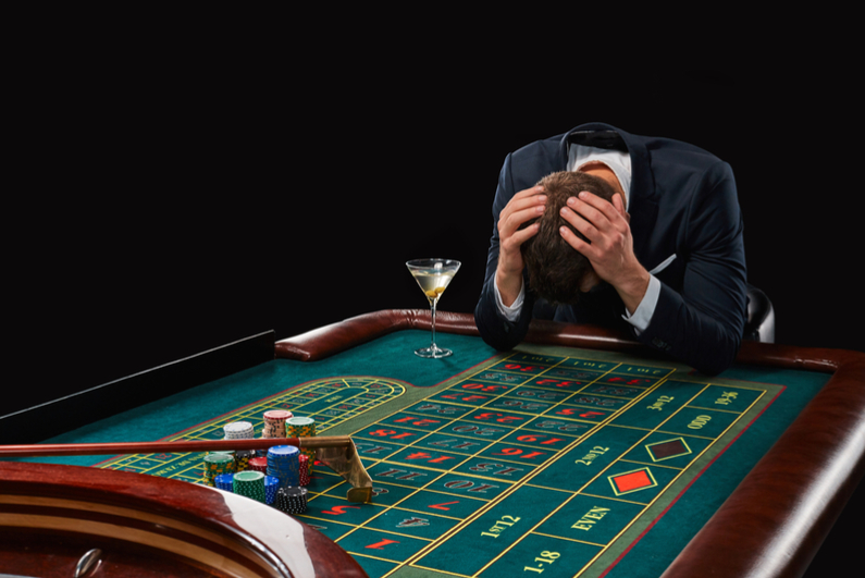 Depressed man at roulette table