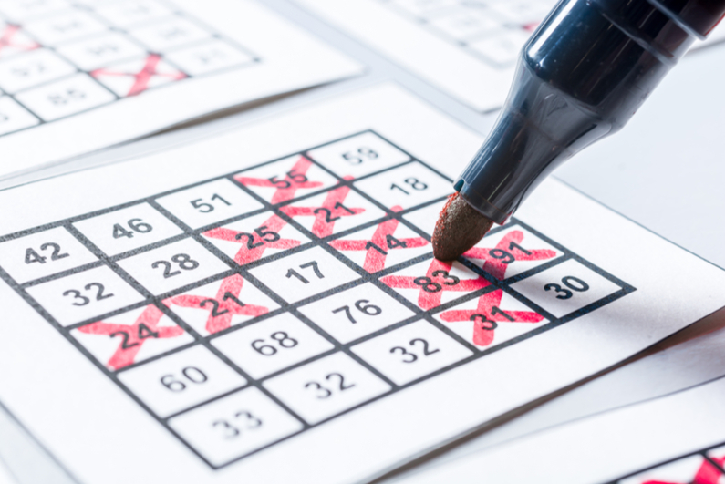 Bingo card being marked in red