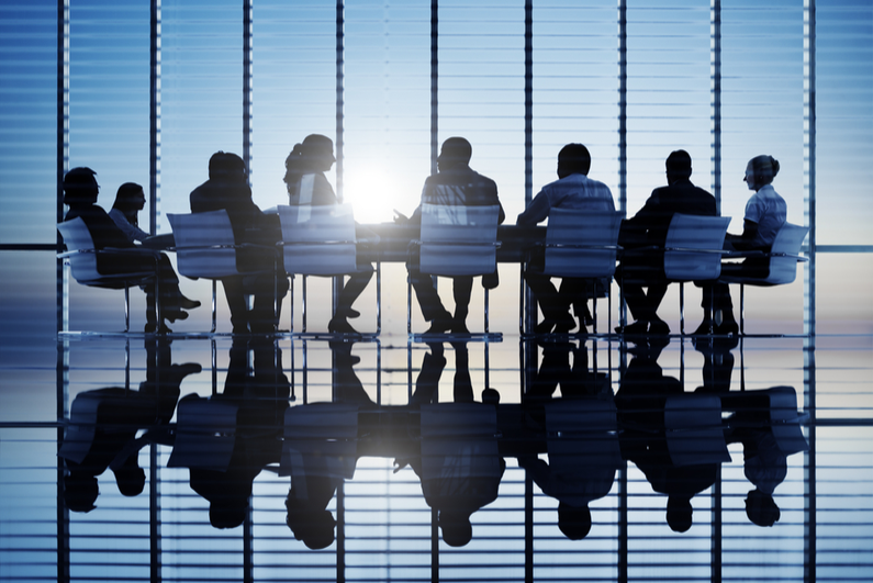 Silhouettes of people in conference room