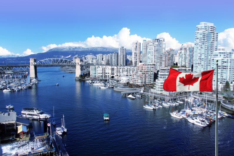 Canadian flag against Vancouver skyline