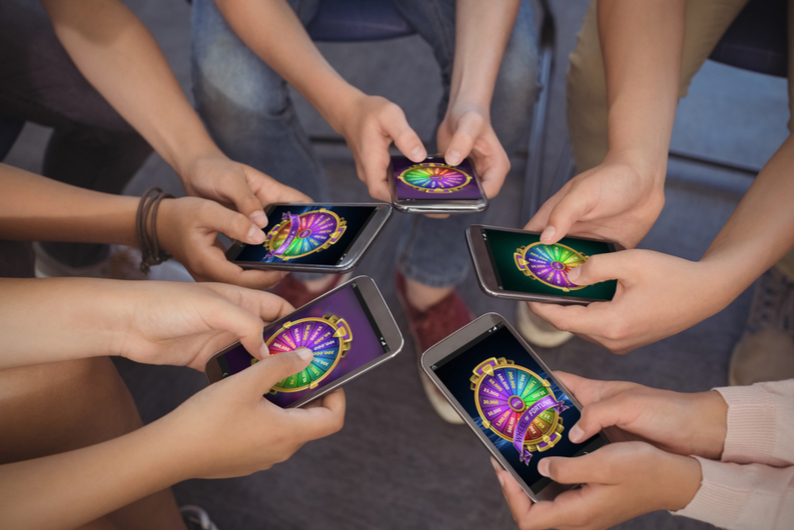 Students viewing wheel of fortune on mobile phones