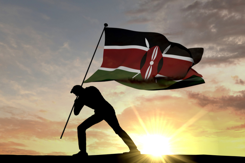 Flag of Kenya being planted in the ground