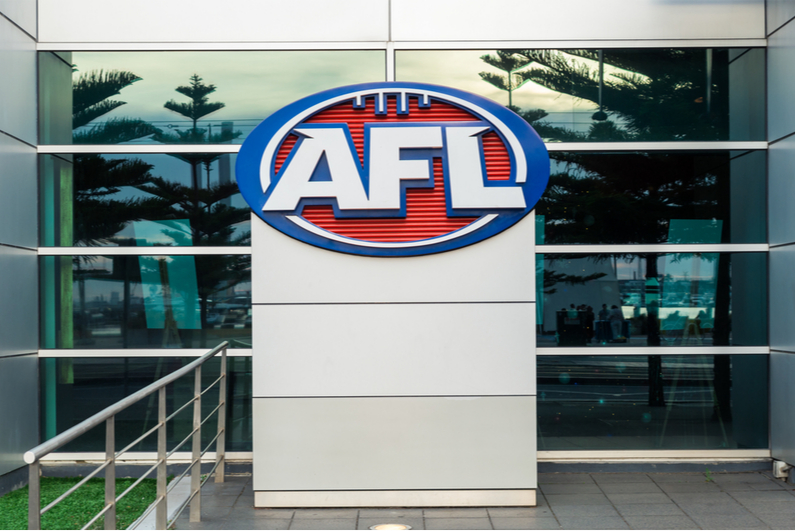 Leading AFL player Easton Wood say he would support a pay cut for players