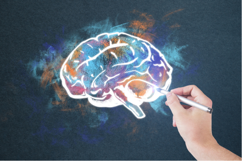 Hand doing colorful drawing of brain