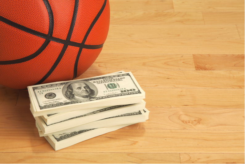 Stack of money with basketball