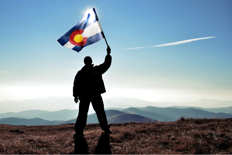 Man waving flag of Colorado