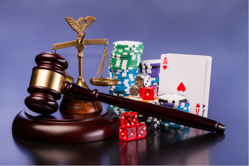 Judge's gavel with dice and cards